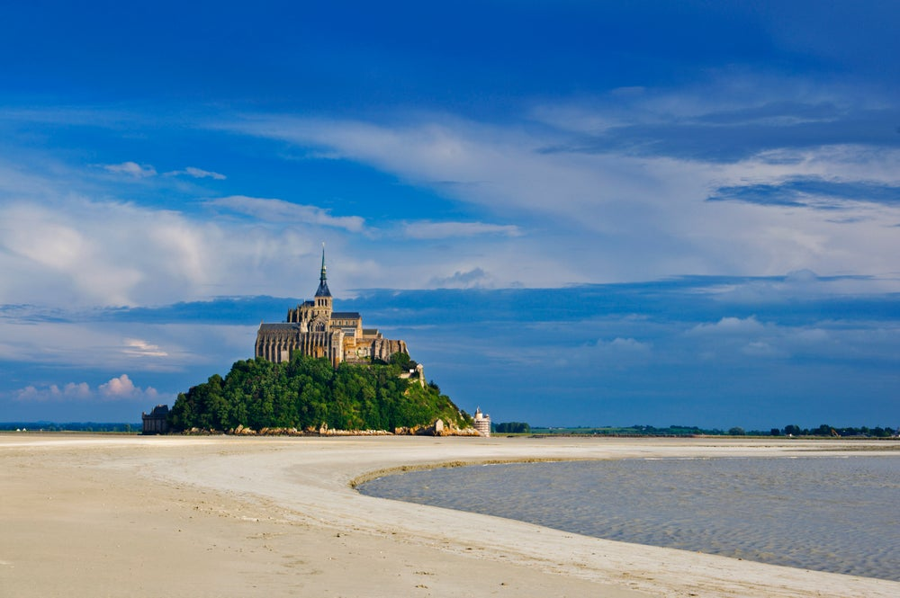 Mont St-Michel poised between land and sea.