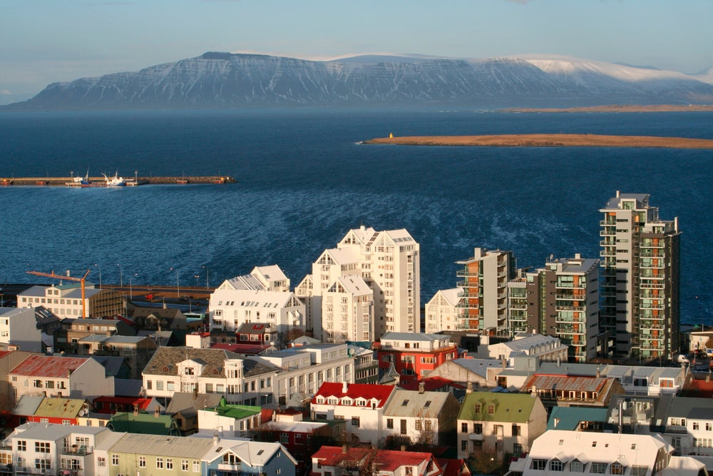 Harbour with mountains in distance.