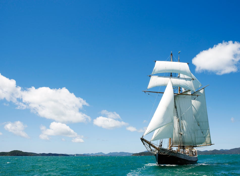 R Tucker Thompson, a 26-metre replica of a working 19th century schooner in Paradise Bay.