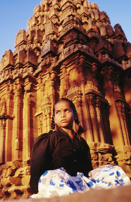 A girl sits in front of a Chalukyan ruin - Badami, Karnataka which most southern Indian temple architecture is based on.