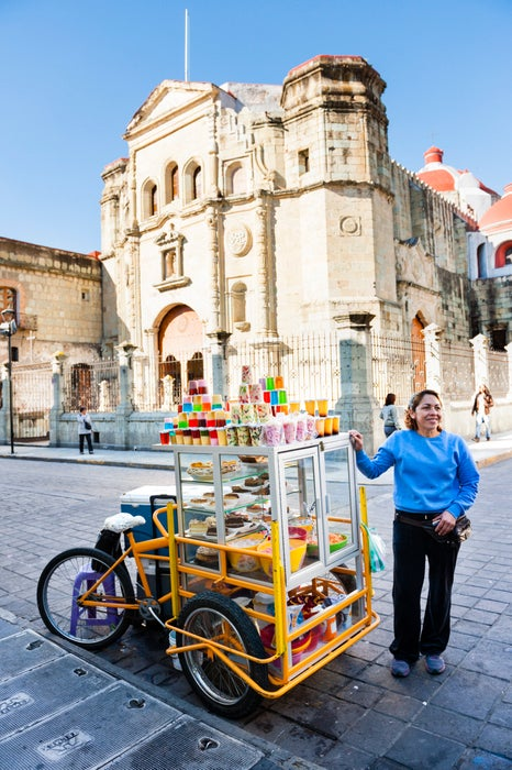 Woman selling Oaxacan deserts from food cart.
