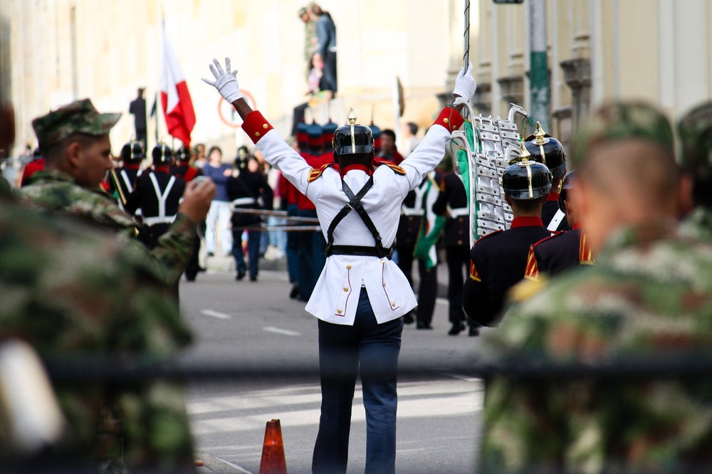 Band leader with band in Presidential Guard procession outside Casa de Narino.