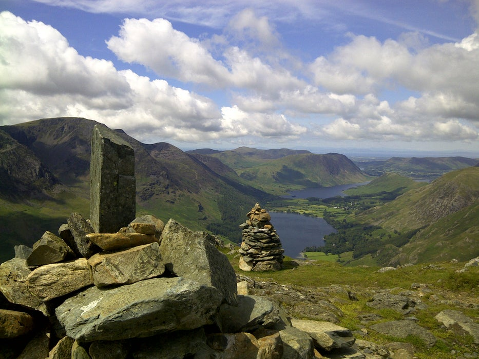 Stone stack high on hill above twin lakes of Buttermere and Crummock Water.