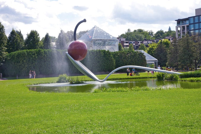 Spoonbridge and Cherry. Claes Oldenburg and Coosje van Bruggen; Spoonbridge and Cherry, 1985-1988 Collection Walker Art Center, Minneapolis; Gift of Frederick R. Weisman in honor of his parents, William and Mary Weisman, 1988; © Claes Oldenburg and Coosje van Bruggen, Minneapolis, USA