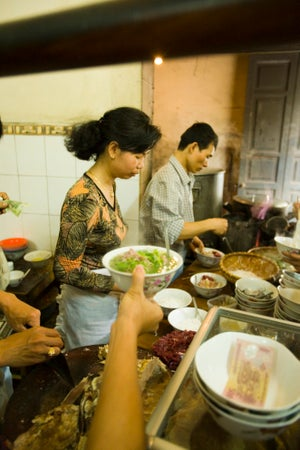 Busy kitchen at Pho Gia Truyen, Bat Dan, Old Quarter, Hanoi, Vietnam