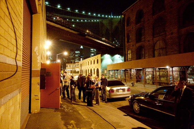 Patrons leave St. Ann's warehouse after a performance in Dumbo, Brooklyn, New York City, USA