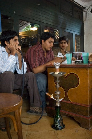 Men at Mocha café smoking, Mumbai, India