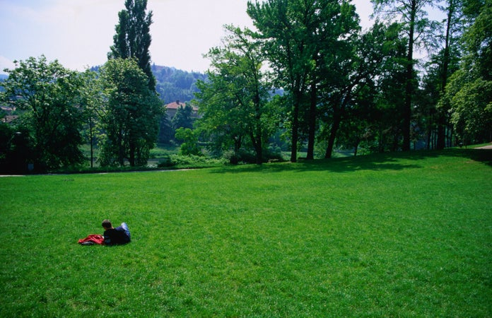 Person relaxing in Parco Valentino, Turin, Italy
