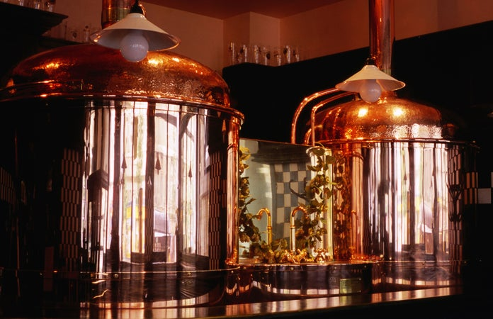 Copper beer vats at Pivovarsky dum micro-brewery pub, Prague, Czech Republic