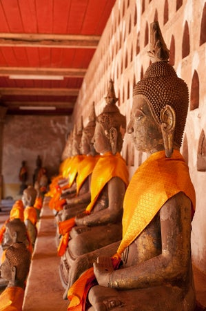Buddhas lining the cloister walls at Wat Si Saket, Vientiane, Laos