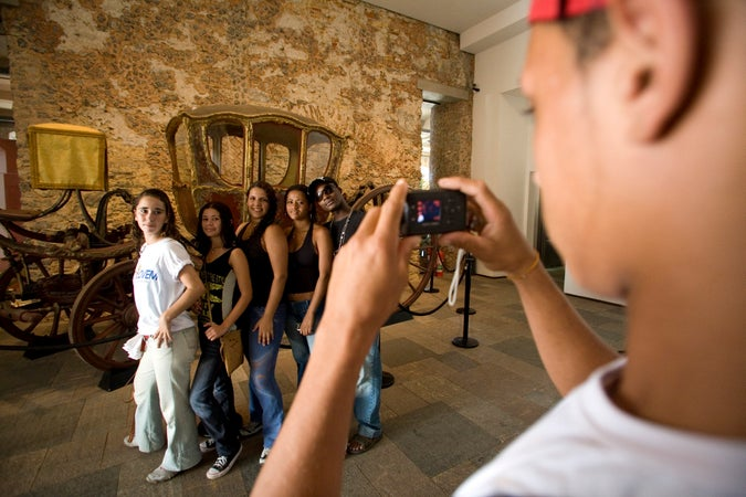 Group of students being photographed at Museu Historico Nacional, Rio de Janeiro, Brazil
