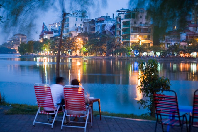 People relaxing beside Truc Bach Lake, West Lake & Truc Bach district, Hanoi, Vietnam