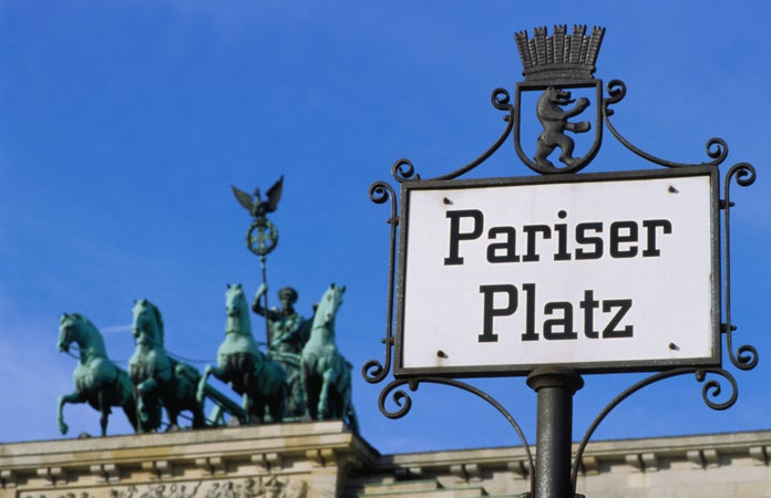 Pariser Platz sign and Brandeburg Gates Quadriga, Mitte, Berlin, Germany