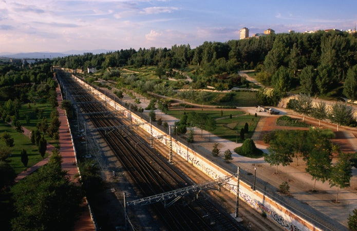 Enormous Casa de Campo and the old Northern Railway line from Telesferico in Madrid, Madrid, Spain