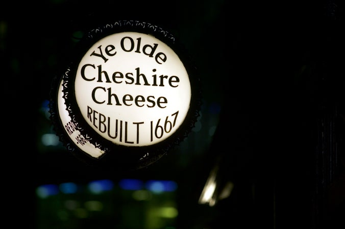 Cheshire Cheese pub sign at night, Fleet Street, London, England