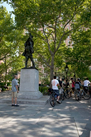Cyclists in Abingdon Square, New York City, USA