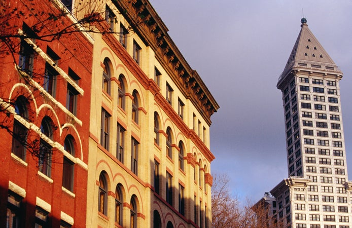 Pioneer Building on left (1889) in Pioneer Square and Smith Tower on the right, Seattle, USA