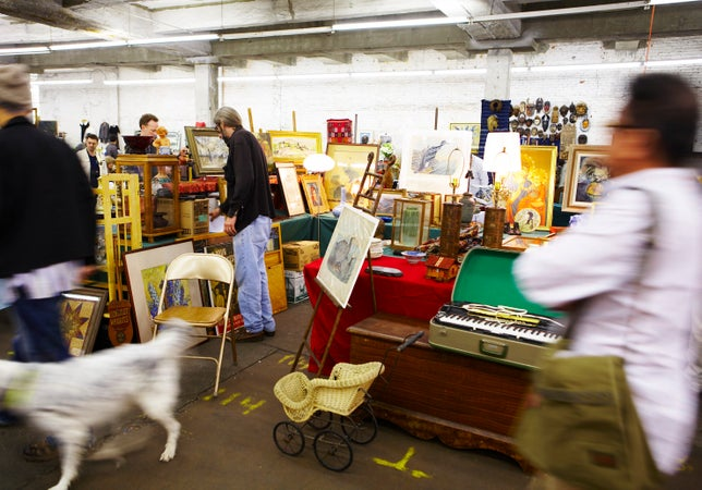 People browsing at Antiques Garage Flea Market in Chelsea, New York City, USA