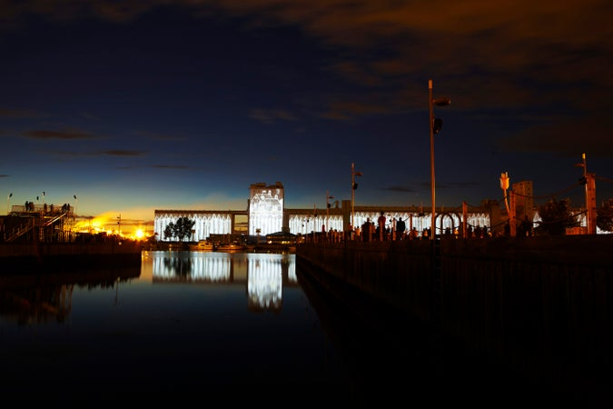 The Image Mill, a light and sound installation on grain silos on waterfront, Québec City, Canada
