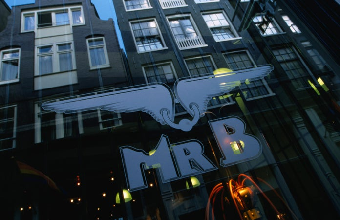 Buildings reflected in the window of Mr B, on Warmoestraat, a shop specialising in leather and rubber gear for the gay clientele, Amsterdam, The Netherlands