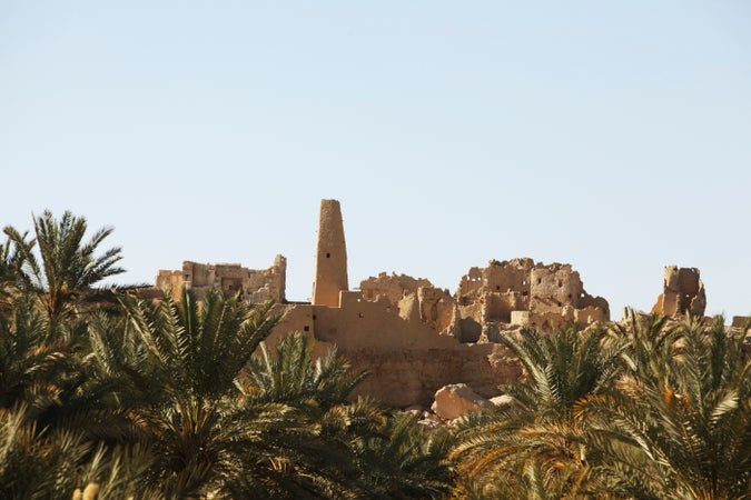 Temple of the Oracle (left) amongst ruined mud buildings, Siwa Oasis, Egypt