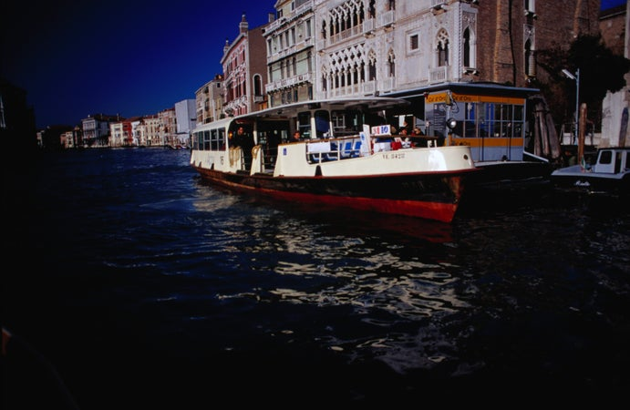 A water taxi passes Ca' d'Oro on the Grand Canal vaporetto (stop) on the No 82, Venice, Italy