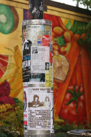 Pole with posters at Britannia Community Centre, 1661 Napier Street, Commercial Drive, Vancouver, Canada