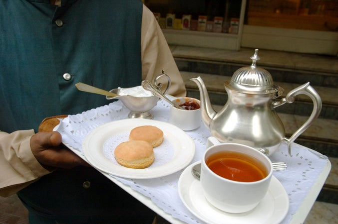 Tray of orange pekoe tea with scones at Tea Centre, Mumbai, India