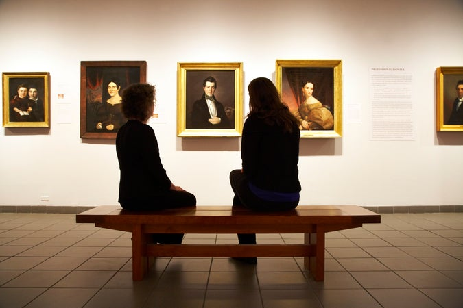 Two women sitting in Folk Art Museum, New York City, USA