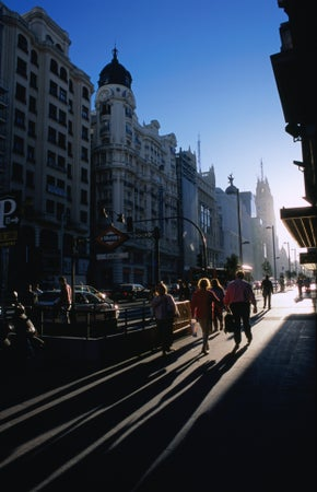 Sunlight streams down the Gran Via in Madrid, Madrid, Spain