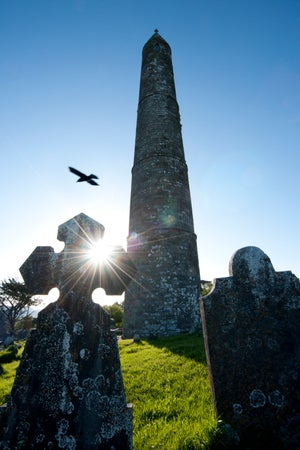 Headstones and Round Tower next to ruins of St Declan's Church, Ardmore, Ireland