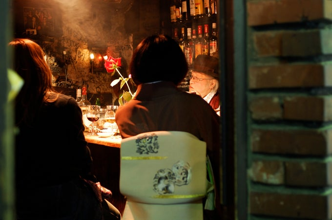 Customers drinking at a tiny, characterful bar in the Golden Gai, Shinjuku, Tokyo, Japan