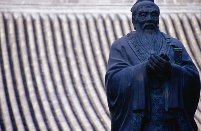 Statue of Confucius in the grounds of the Imperial College in Beijing, Běijīng, China