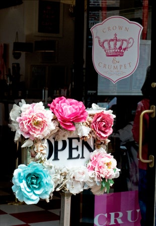 Flowers on open sign at Crown and Crumpet Tea Room, San Francisco, USA