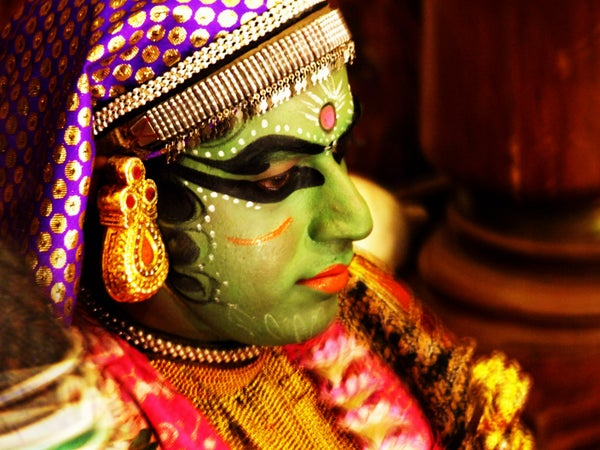 Green faced Kathakali dancer in costume, Kochi (Cochin), India