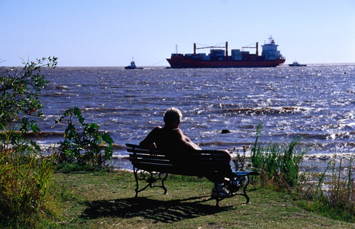 Relaxing on the waterfront in the Reserva Ecologica Costanera Sur, created in 1986 in order to preserve part of the city's coastal area, Buenos Aires, Argentina