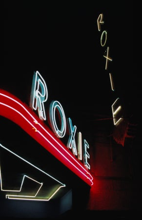 Neon signs outside the Roxie Theater on 16th Street, at night, San Francisco, USA