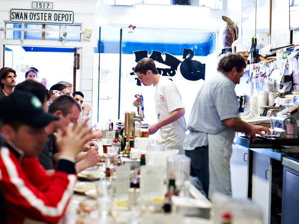 People dining at counter of Swan Oyster Depot, San Francisco, USA