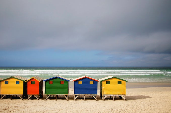 Brightly coloured beach huts on Muizenberg Beach, Cape Town, South Africa