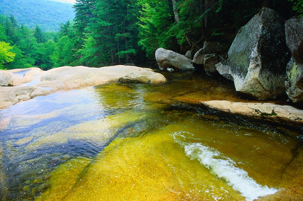 The calm water at the top of a waterfall in the White Mountains - New England, Vermont