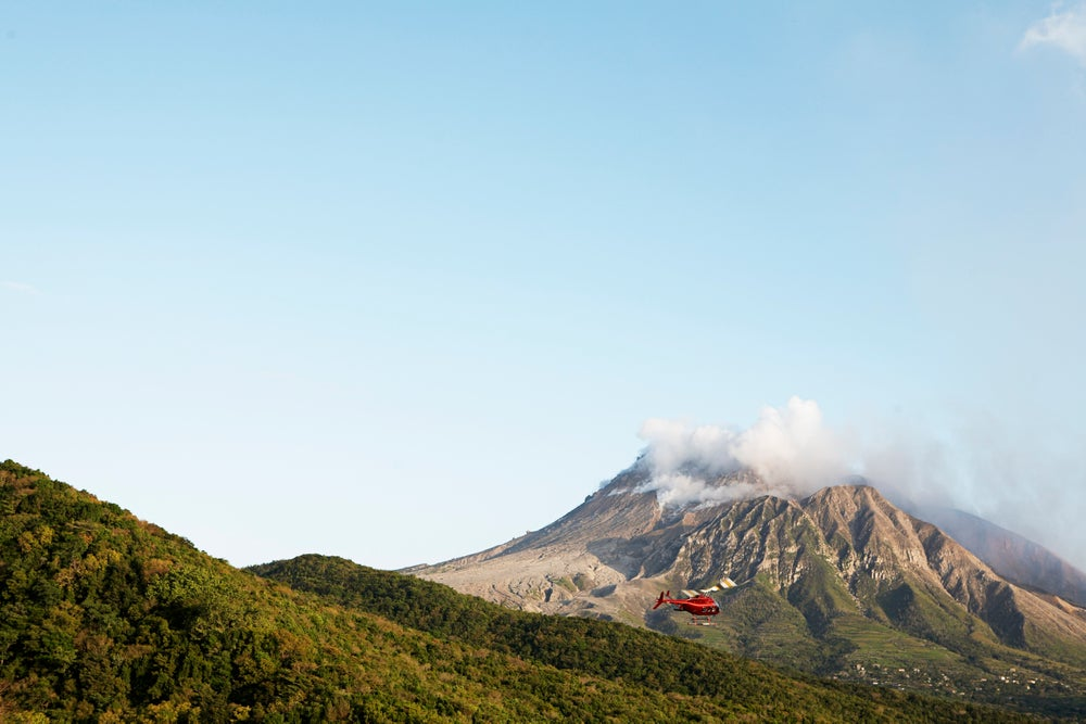 Helicopter flying near Soufriere Hills volcano.