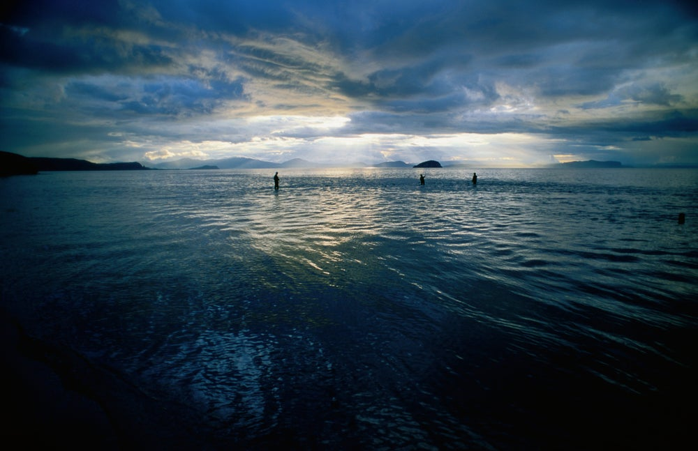 Sunlight over Lake Taupo, the largest lake in New Zealand.