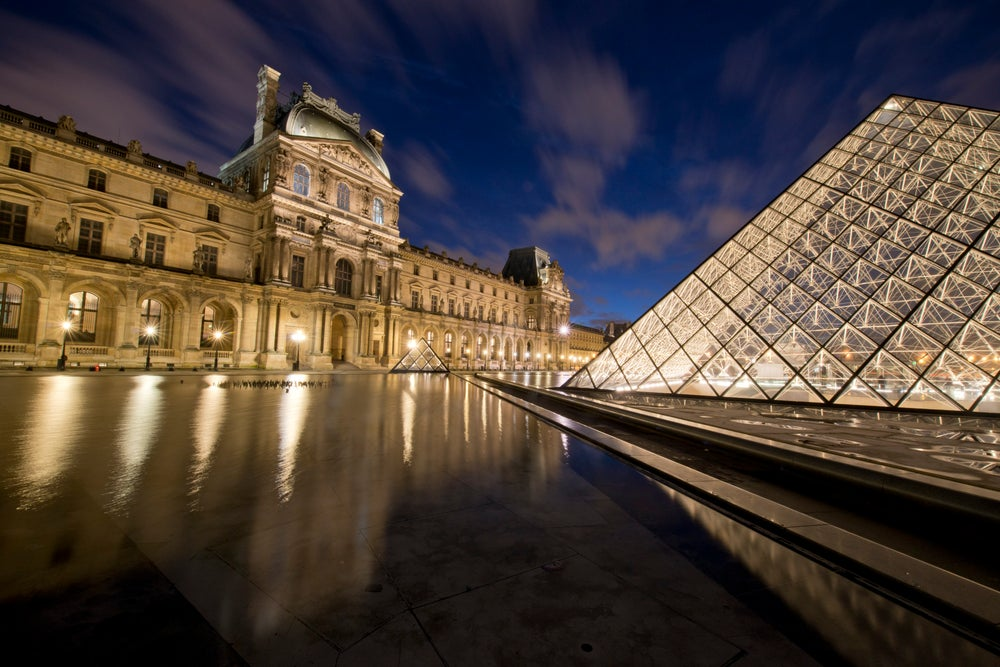 Central courtyard of Louvre at dusk.