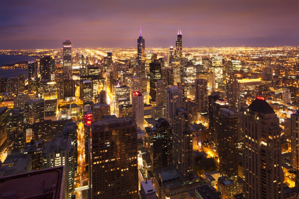 Overview of bright lights of Chicago at night.