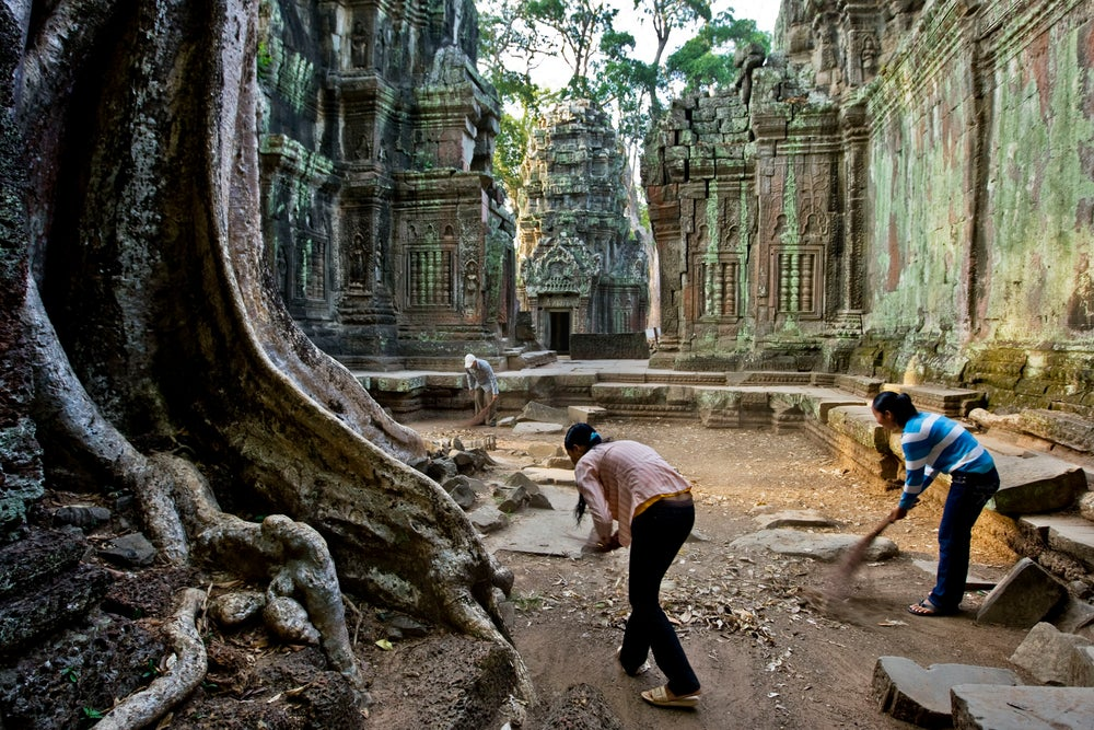 Sweeping during morning cleaning at Ta Prohm.