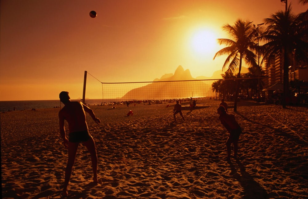 People playing volleyball at Ipanema beach.