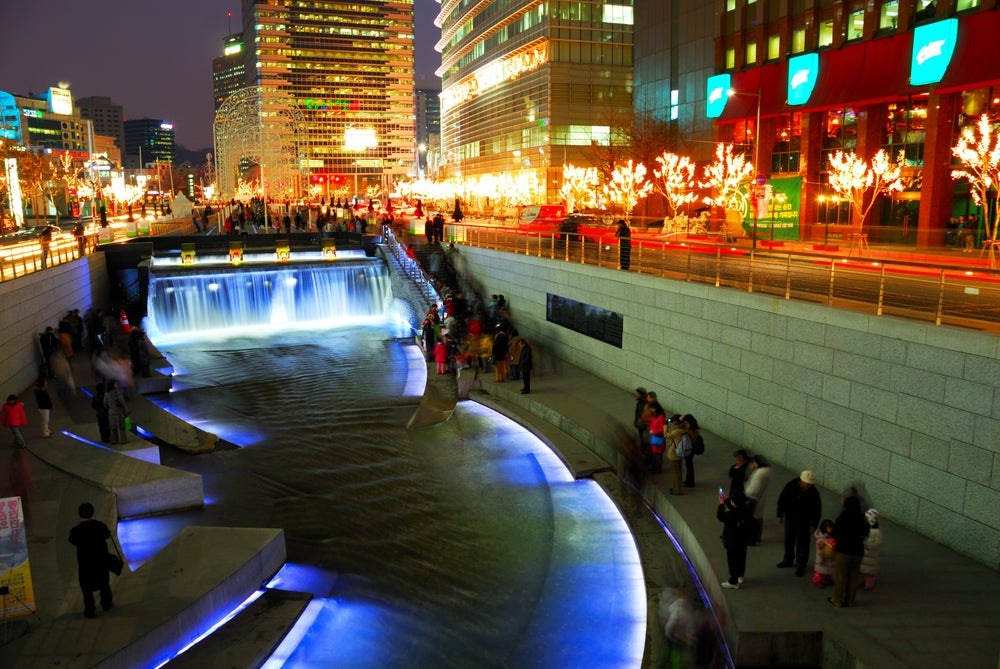 The Cheonggyecheon Stream draws crowds of locals out in early evening.
